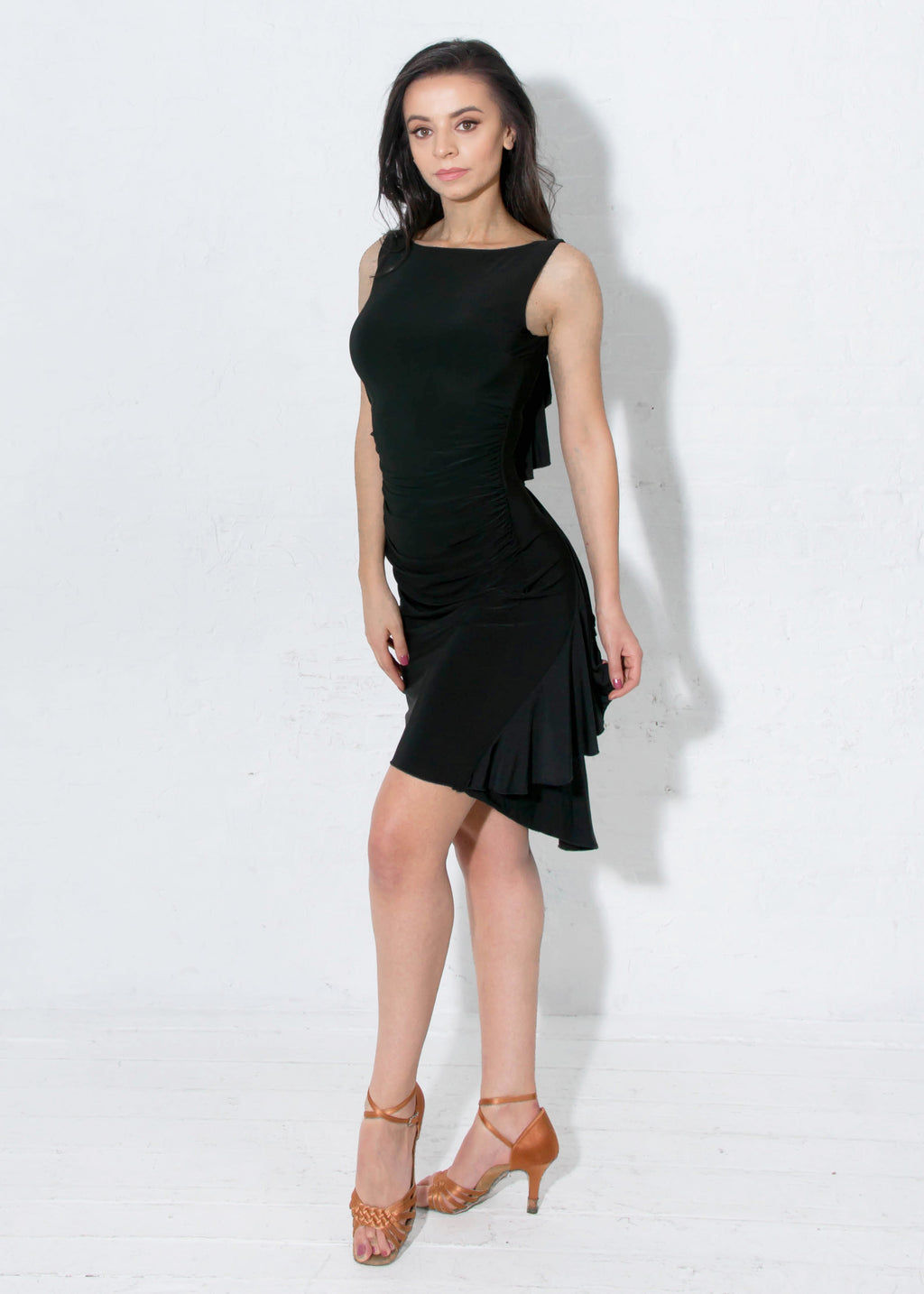 Boat neck neckline and side seam ruching gives this latin ballroom dance dress a super sleek silhouette. Includes a shelf bra. Knee-length for most heights (5'3-5'5).