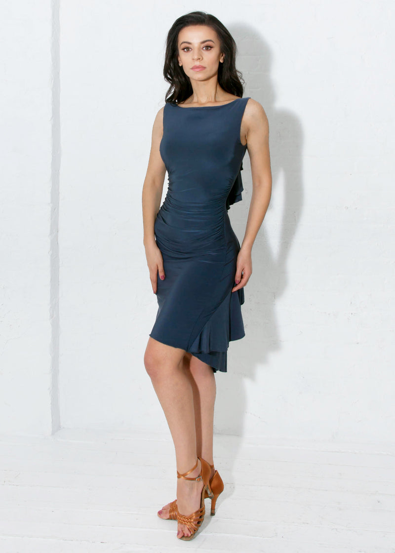 Boat neckline and side seam ruching gives this latin ballroom dance dress a super sleek silhouette. Includes a shelf bra. Knee-length for most heights (5'3-5'5).