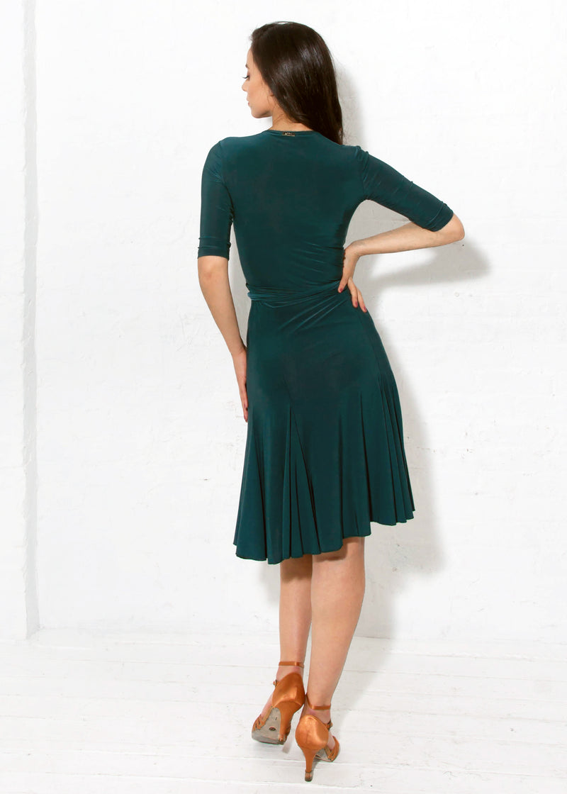 Miari Forrest Green Klaudia Wrap is a true wrap dress with an attached belt that loops through the dress and ties on the side.