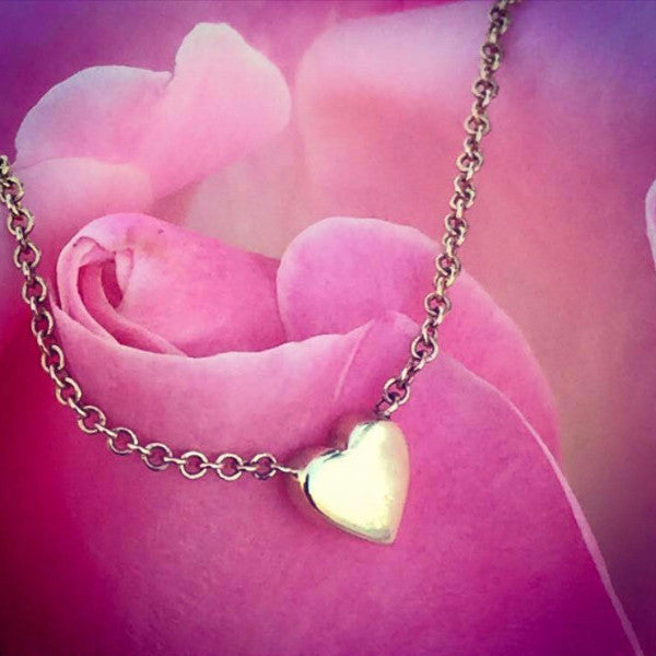 Dainty heart necklaces made by hand in solid 18k gold and 18K Italian gold chains. Available in solid rose, yellow and white gold and also with diamonds. Made by hand in U.S.A.  Free shipping on all domestic orders.