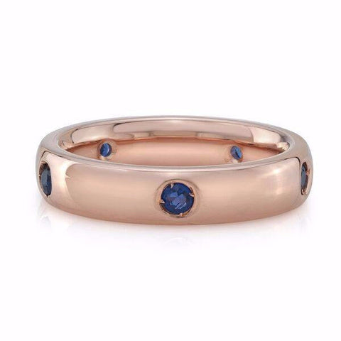The sapphire ring is made by hand in solid 18k gold and Ceylon sapphires. Available in solid rose, yellow and white gold. Made by hand in USA. Free shipping in all domestic orders