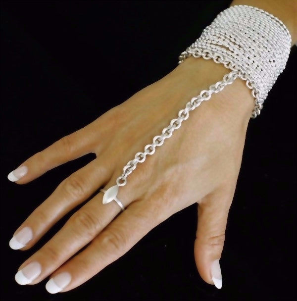 The VERO Ring bracelet is one of Paulina's signature pieces. This exotic one piece bracelet is made by hand in solid sterling silver and Italian sterling silver chains. Made by hand and to order in USA. www.paulinajewelry.com
