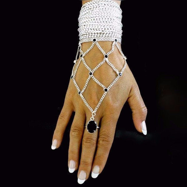 The Reymi ring bracelet by PAULINA jewelry is made by hand in solid sterling silver, Italian sterling silver chains and stones. Made by hand and to order in U.S.A. Available with different kind of stones. Expected shipping 10-14 business days.