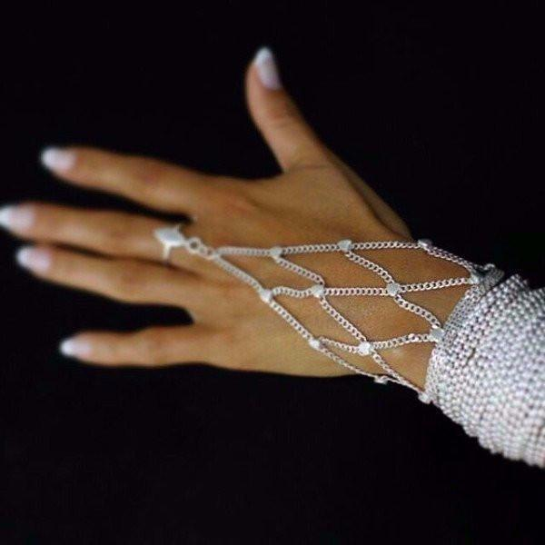 The Paulina ring bracelet is made by hand in solid sterling silver and Italian sterling silver chains. The ring is adjustable. Made by hand in USA. Expected shipping 10-14 business days