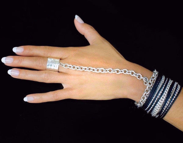 The JM ring bracelet is made by hand in solid sterling silver, Italian sterling silver chains and rubber from India. The solid tag is embellished with a signature black diamond. Made by hand and to order in USA. Free shipping on all domestic orders. www.paulinajewelry.com