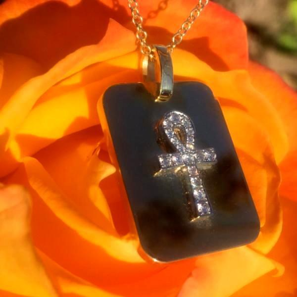 These stunning J-R dog tags with ankhs are made by hand in solid 18K gold, Italian gold chains and brilliant diamonds. Available in solid rose, yellow and white gold. Made by hand and to order in USA. www.paulinajewelry.com