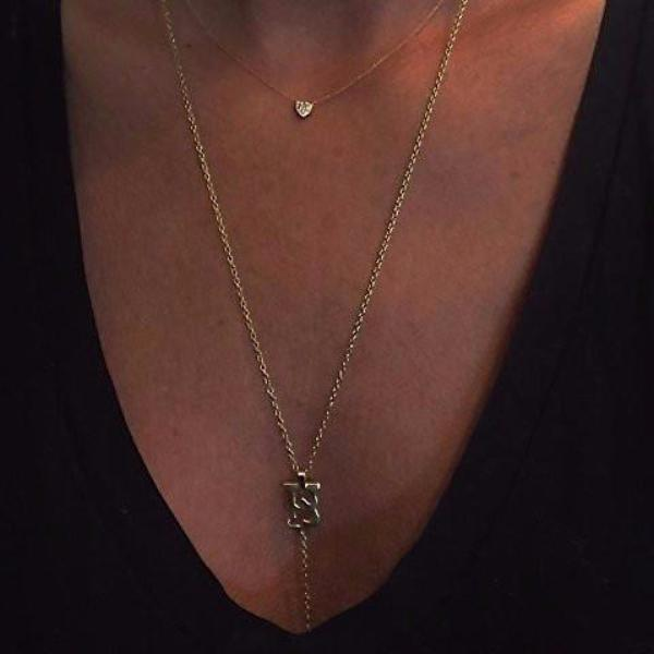 The HU body chain is made by hand in solid gold and Italian gold chains. Made by hand and to order in USA. Also available in solid silver. Free shipping on all domestic orders. www.paulinajewelry.com