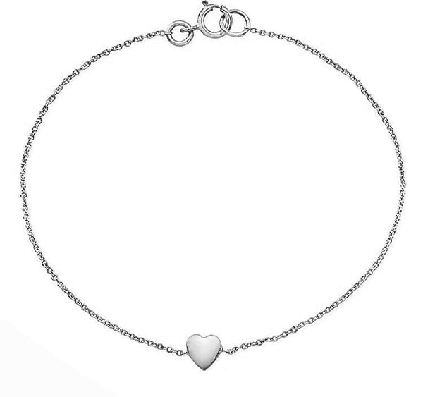 Dainty heart bracelets made by hand in solid 18K and 18K Italian gold chains. Available in rose, yellow and white gold and also with diamonds. Made by hand in USA.