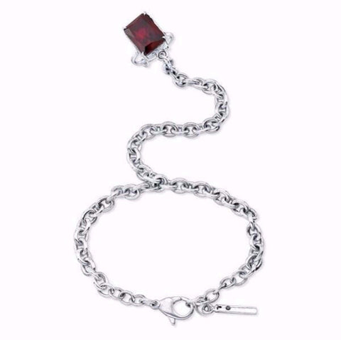 The Nini ring bracelet is made by hand in solid sterling silver, Italian solid sterling silver chains and a Garnet stone. Also available with other stones. The solid silver tag as a signature black diamond. Made by hand and to order in USA. Free shipping on all domestic orders. www.paulinajewelry.com