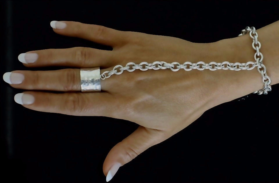 The JM ring bracelet is made by hand in solid sterling silver and Italian silver chains. The solid tag is embellished with a signature black diamond. Made by hand and to order in USA. Free shipping on all domestic orders. www.paulinajewelry.com
