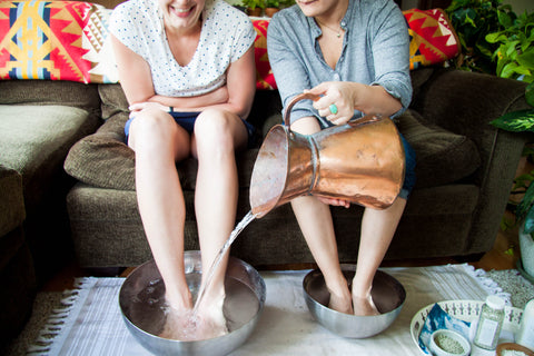 girls in foot soak with copper pitcher