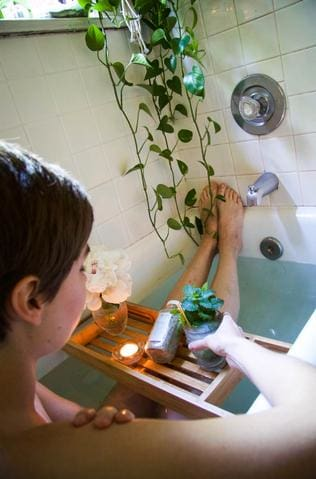 girl in bathtub with cocktail