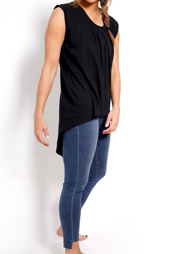 NSF Clothing's Cassidy Pleated Top is a perfect high low tank top that is perfect for layering and pairing with your favorite denim and leather jacket