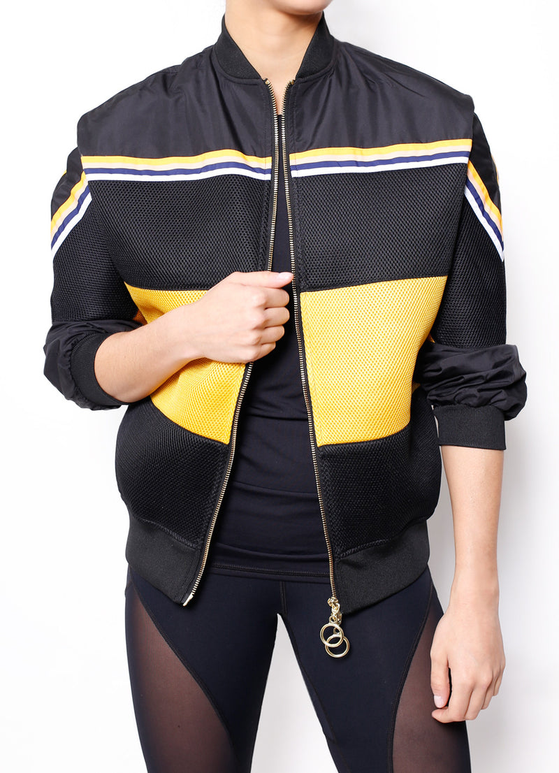 PE nation wild card jacket is an update to the classic bomber jacket.  Has yellow mesh paneling, gold hardware, and horizontal stripes across the chest.  One of the Kardashians favorite activewear brands.