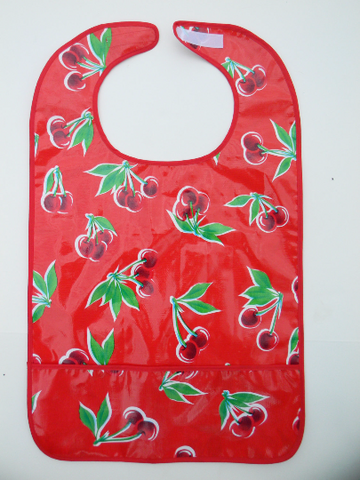 "Adult Oil Cloth Bib 6""Pocket - RED CHERRY & RED TRIM 36"" x 18"""