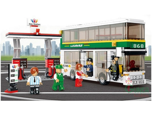 Double Decker Bus and Gas Station