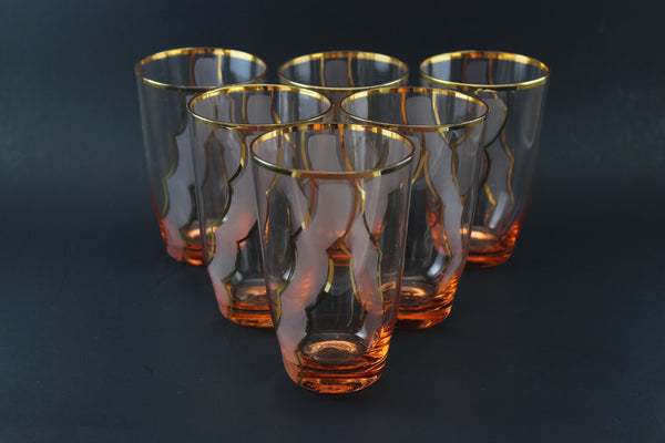 Pink crystal tumblers with gold accents