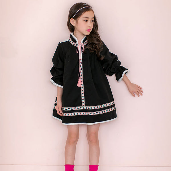 Girl's Dorothy Tassel Dress in black with geometric patterns