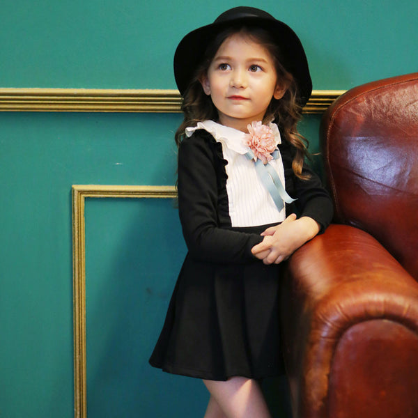 Little girl's Hazel Flare Dress in black with ruffle details