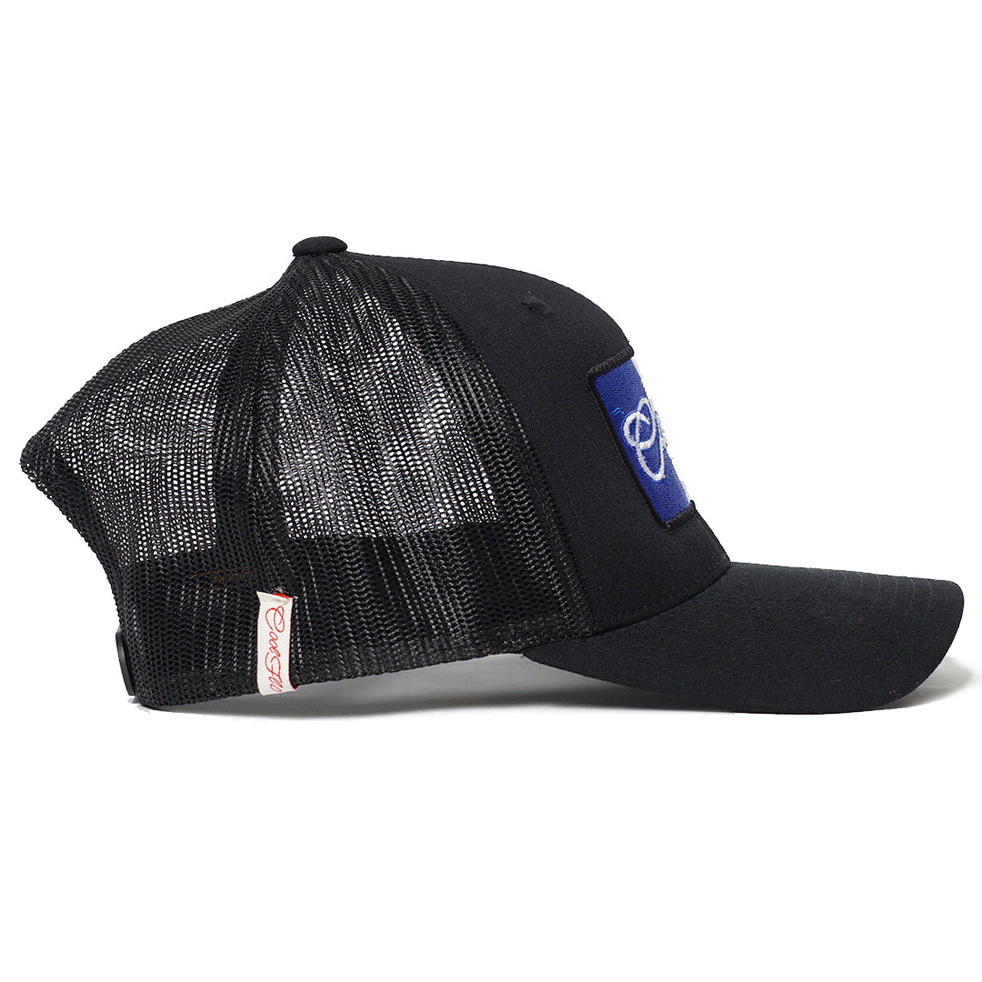 Side view of Black Cool Flo trucker cap with French flag embroidered design.