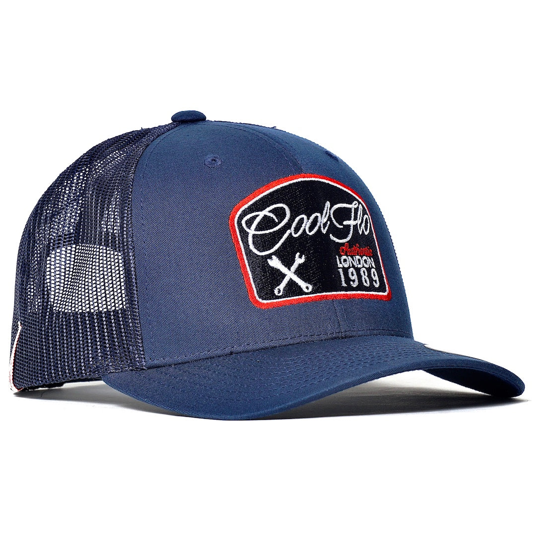 Cool Flo Workshop Navy Trucker cap with embroidered badge design featuring spanners