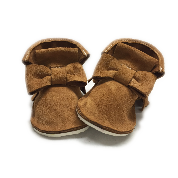 Tan caramel genuine suede high top bow moccasins, mini boots