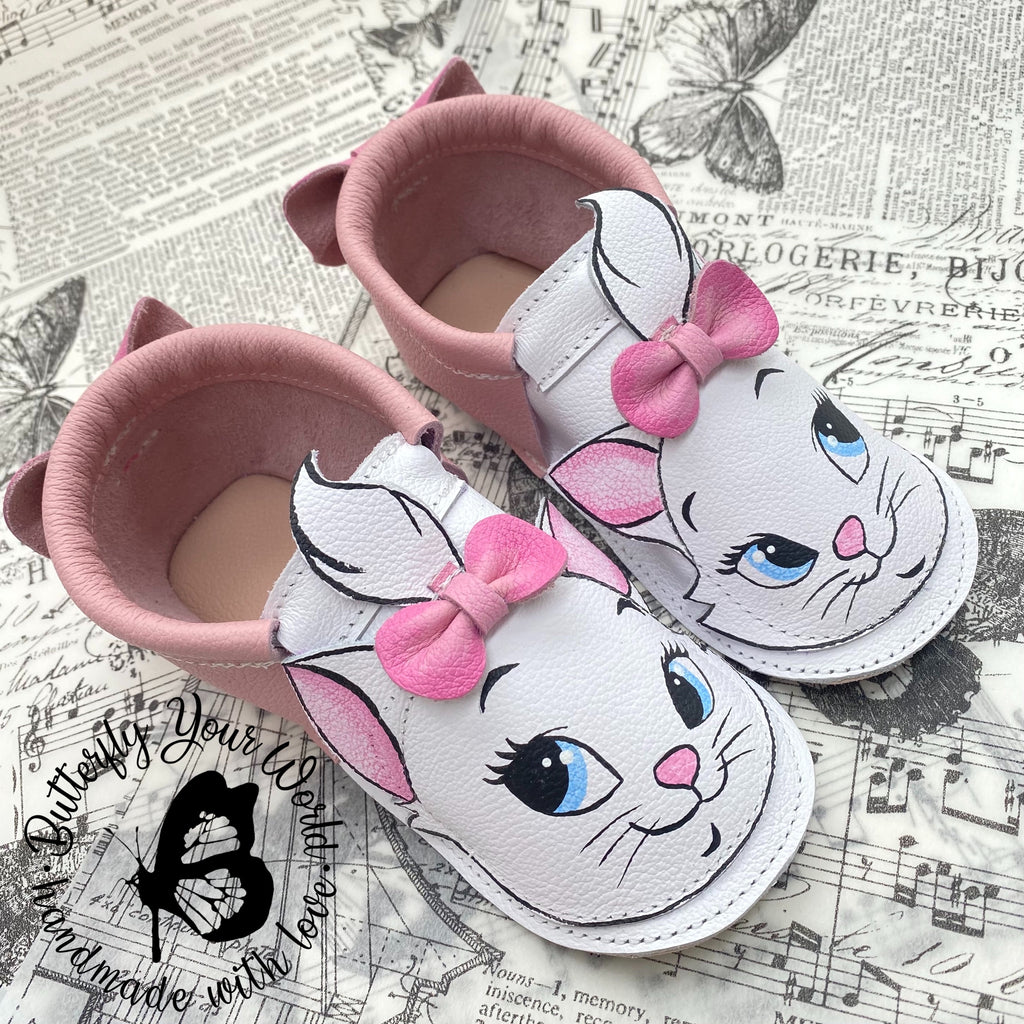 White Cat moccasins with rubber soles