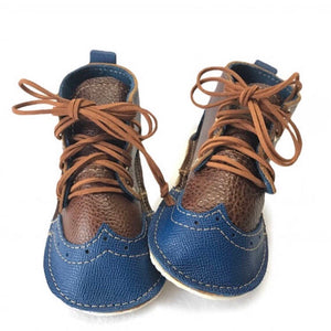 Wingtip oxford booties with rubber soles