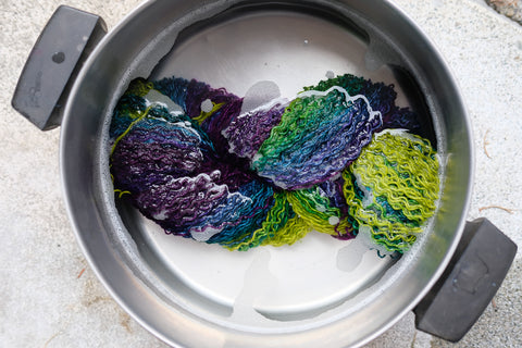 yarn soaking in a pot of water