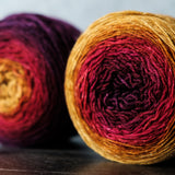 Gradient sock-weight yarn: gold, red, purple