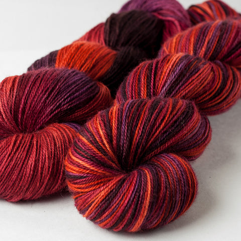 Willow Sock: orange, red, brown, purple