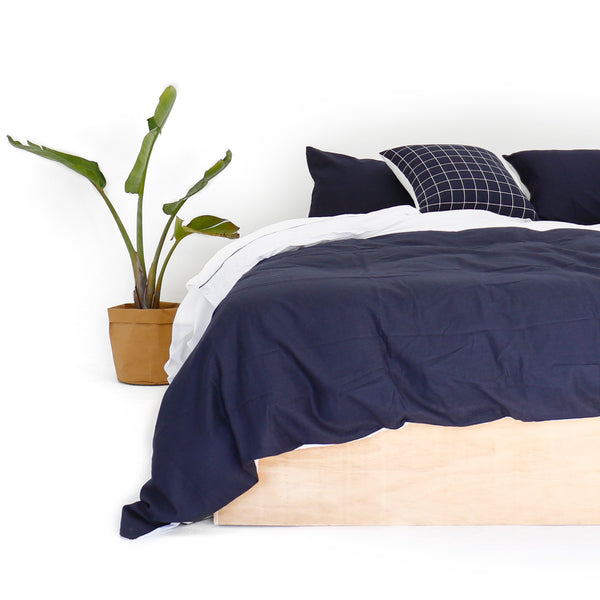 WHITE GRID NAVY CUSHION