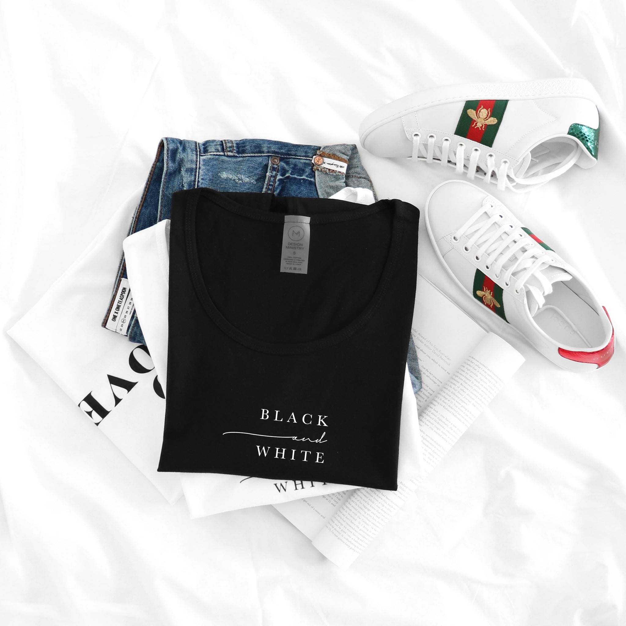 Gucci shoes and black t-shirt with text by Design Ministry