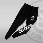 DEADLY. SPORTS Logo in white on the front and back leg of a pair of jog bottoms.