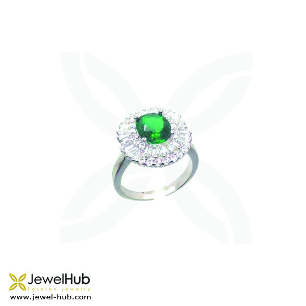 An emerald Baguette cz stone twinkles on the silver ring.