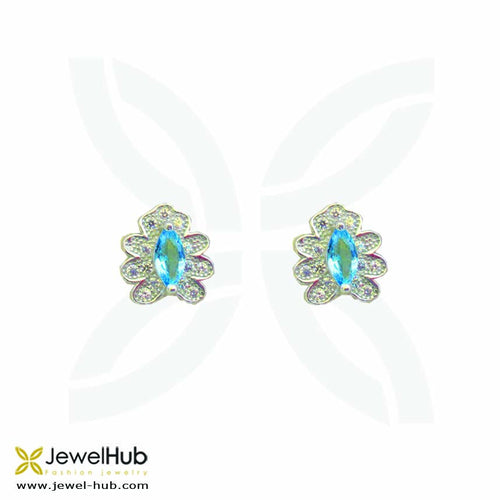 Twinkling stone is embedded into the sterling silver earrings and surrounded by white crystals.