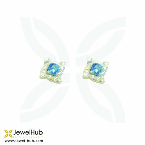 Blue stones with twinkling white crystals on its side, forming a geometric pattern.