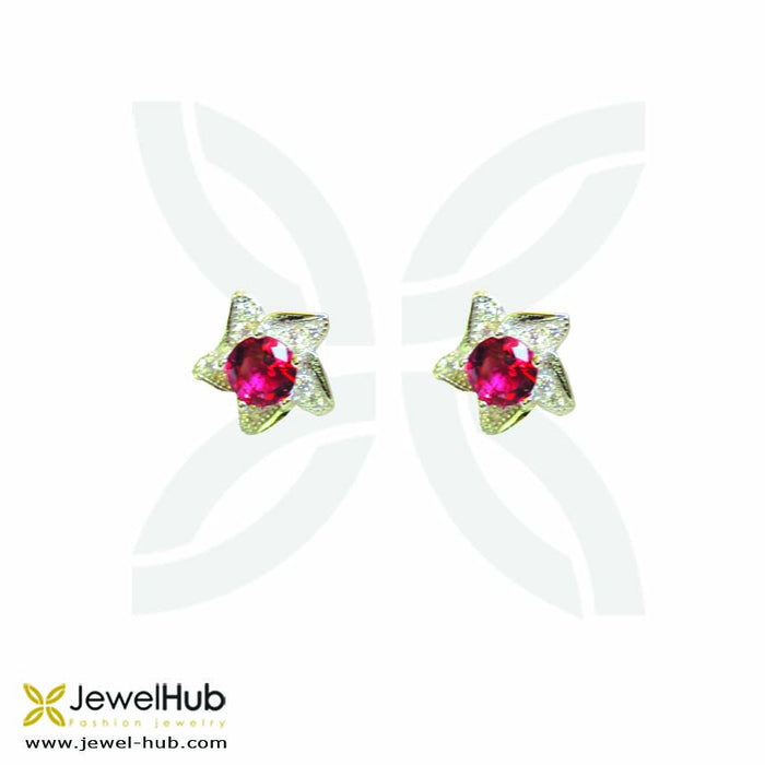 Star earrings in silver with embedded ruby stones.