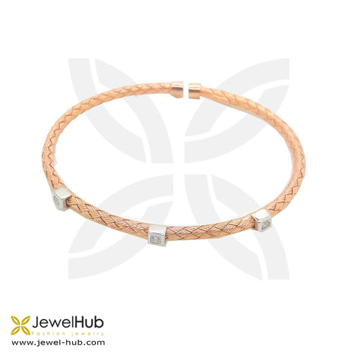 A rose gold bangle with twinkling silver buckles.