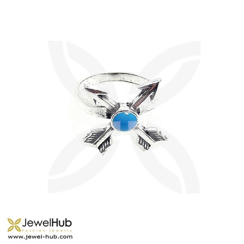 Cross arrows with twinkling blue crystal in the middle.