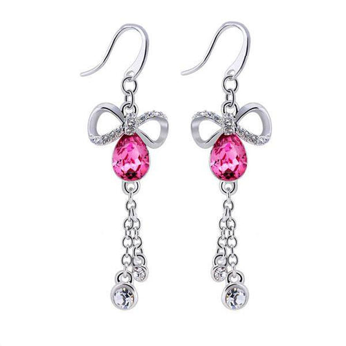 Pink Swarovski crystals, silver beads and the silver bow tie set up a lovely rhythm in sterling silver earrings.