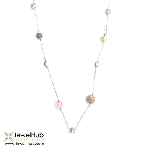 The pearl, cubic zirconia and agates set up a lovely rhythm in the silver necklace.