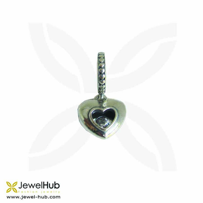 A delicately wrought heart silver charm with twinkling crystal