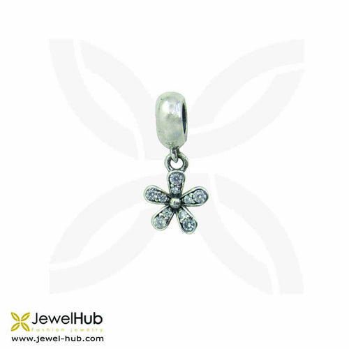A flower oxidized silver charm with white crystals.