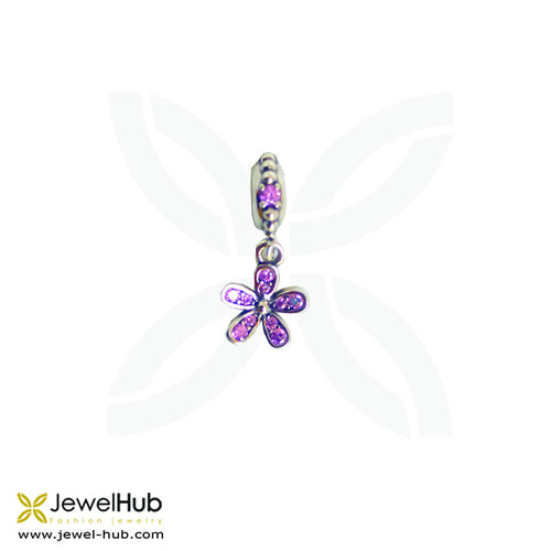 A flower charm with pink crystals embedded on it.