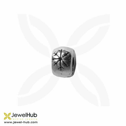 An delicately engraved snowflake in the charm.