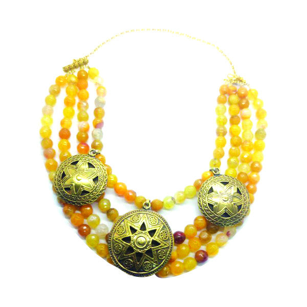 A necklace with vivid agate stones and gold-plated drops.