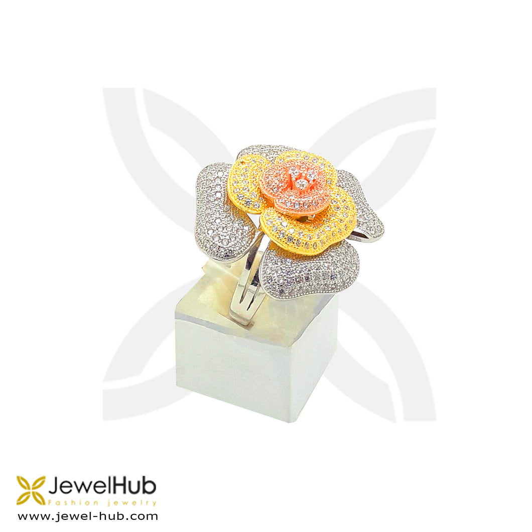A colorful flower with rose gold, silver and gold colors with embedded twinkling cubic zirconia.
