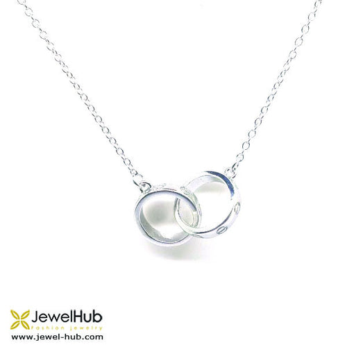 Two circles are bonded closely together by sterling silver link.