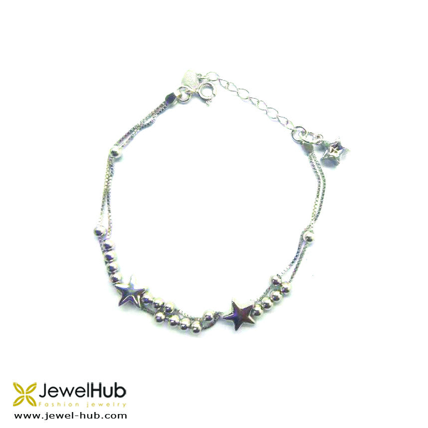 Numerous silver beads and stars are attached to the double silver link randomly.
